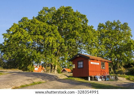 HARSTENA, SWEDEN â?? SEPTEMBER 30, 2015:Cottage and ships on the island Harstena in Sweden, principally known for the seal hunting that was once carried out there. It is now a tourist attraction.