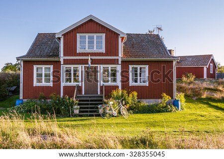 HARSTENA, SWEDEN â?? SEPTEMBER 30, 2015:Red cottages on the island Harstena in Sweden, principally known for the seal hunting that was once carried out there. It is now a tourist attraction.