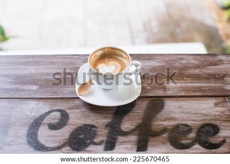 Hart drawing on latte art coffee cup - stock photo