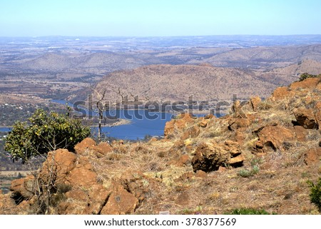 Hartbeespoort Dam seen from the top of Magaliesberg mountain - stock photo