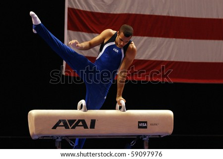 HARTFORD; CT - AUGUST 13: Gymnast Danell Leyva performs on the pommel horse during the men's competition at the VISA Gymnastics Championships in Hartford; CT on August 13, 2010. - stock photo