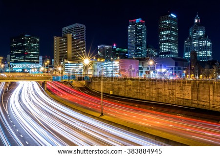 Hartford skyline by night, with rush hour traffic on Yankee expressway. Hartford is the capital of Connecticut.