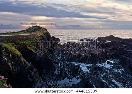 Hartland Point, Cornwall, England, UK. Sunset across the Atlantic Ocean. - stock photo