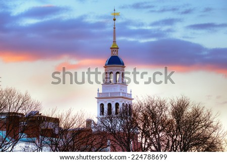 Harvard University. Detail of Eliot House's blue dome and bell tower at dusk. - stock photo