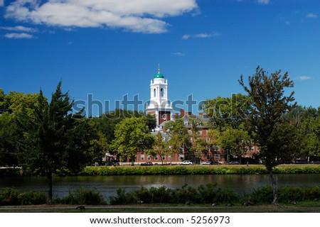 Harvard University Elliot House from across Charles River - stock photo