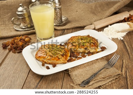 Harvest cake with dried grape and lemonade - stock photo