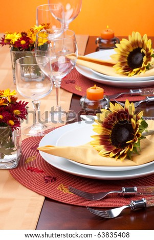 Harvest festive dinner table setting with sunflowers. - stock photo