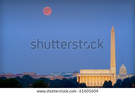 Harvest moon over Washington, DC, with Lincoln Memorial, Capitol and Washington Monument - stock photo