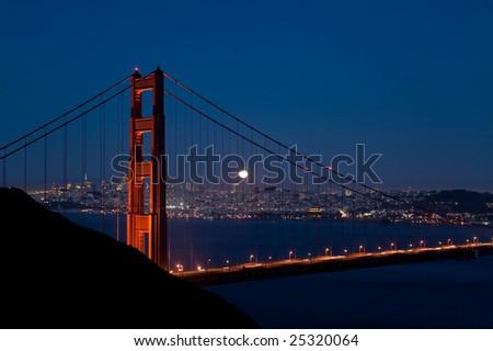 Harvest moon rises over the Goldengate Bridge - stock photo