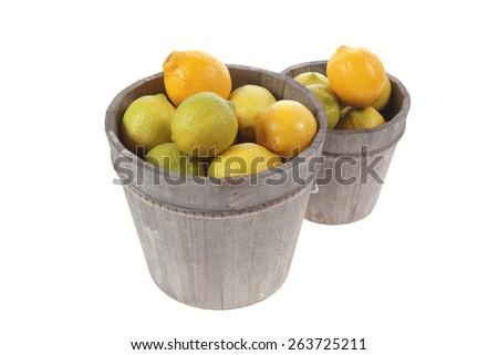 harvest of fresh raw lemon in wooden bucket isolated over white background - stock photo