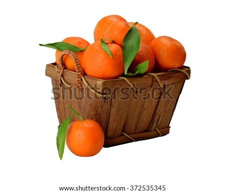 Harvest ripe tasty tangerine in a wooden basket isolated on white background without shadows. - stock photo