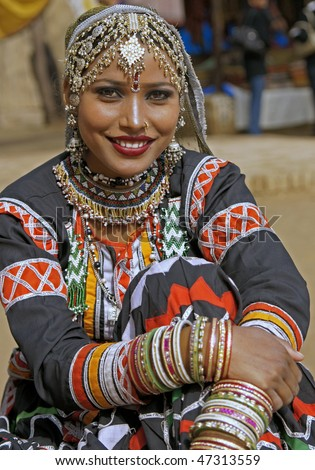 HARYANA, INDIA - FEBRUARY 12:Beautiful Kalbelia dancer in ornate black costume trimmed with beads and sequins on February 12, 2009 at the Sarujkund Fair near Delhi in India. - stock photo