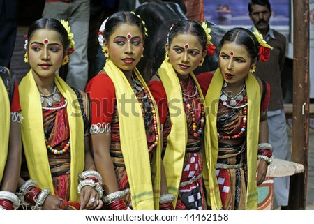 HARYANA, INDIA - FEBRUARY 12: Group of teenage Indian dancers in traditional tribal outfit on February 12, 2009 at the Sarujkund Craft Fair in Haryana near Delhi, India. - stock photo