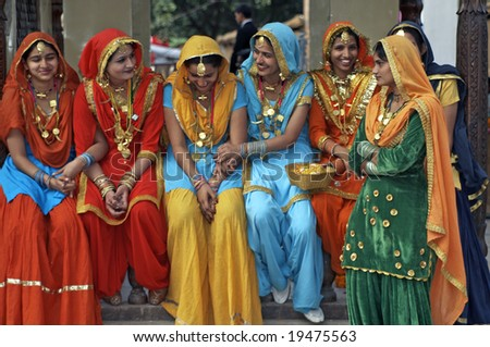 HARYANA, INDIA - FEBRUARY 15: Unknown group of colorfully dressed Indian ladies at a festival on February 15, 2007 at the Surajkund Mela, Haryana, India