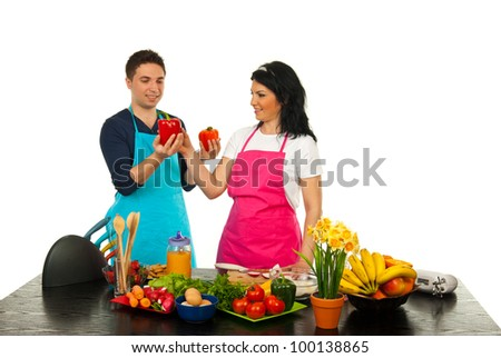Hasband giving to his wife to choice pepper isolated on white background