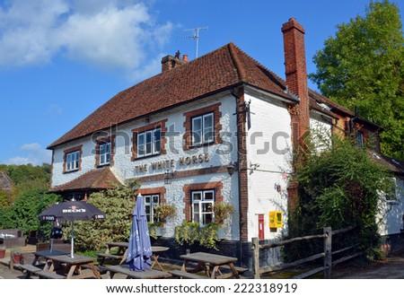 Hascombe, United Kingdom - September 30, 2014: The historic  White Horse Pub at Hascombe, Surrey UK in Summer. - stock photo