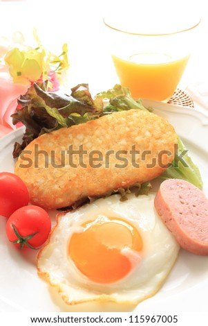 Hash brown and sunny side up with luncheon meat for hawaiian breakfast image