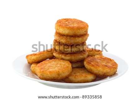Hash browns on white plate, isolated on white background.