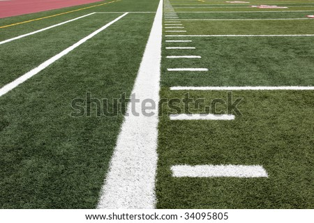 Hash marks on football field near out of bounds line - stock photo