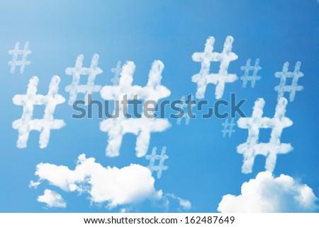 Hashtag cloud shape form on sky. - stock photo