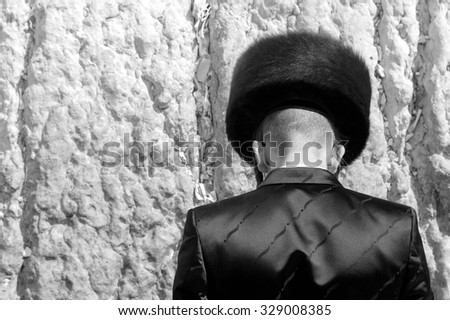 Hasidic  Jew Praying at the Wailing Wall in Jerusalem - stock photo