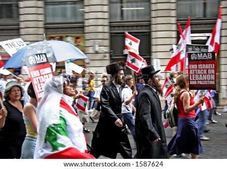 Hasidic Jews marching along pro Lebanese demonstrators - stock photo