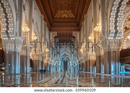 Hassan II Mosque interior corridor with columns in Casablanca Morocco. Arabic arches, ornaments, chandelier and lighting. - stock photo