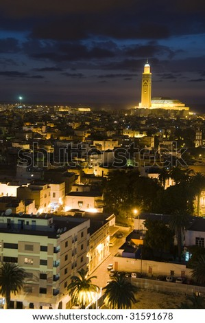 Hassan II mosque night scene at dusk sundown with lights overlooking the Atlantic Ocean in Casablanca Morocco Africa which is the largest mosque in Morocco and the third largest mosque in the world - stock photo
