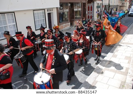 HASTINGS, ENGLAND - JULY 30: The Section 5 drummers perform at a parade during the Old Town Carnival Week on July 30, 2011 in Hastings, East Sussex, England. The carnival was founded in 1968.