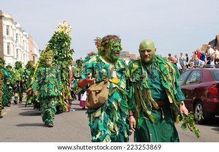 HASTINGS, ENGLAND - MAY 5, 2014: Costumed people dressed as trees take part in the parade on the West Hill during the annual Jack In The Green festival. The event marks the May Day public holiday.  - stock photo
