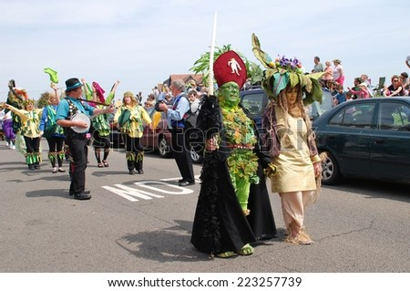 HASTINGS, ENGLAND - MAY 5, 2014: Costumed people take part in the parade on the West Hill during the annual Jack In The Green festival. The event marks the May Day public holiday. - stock photo