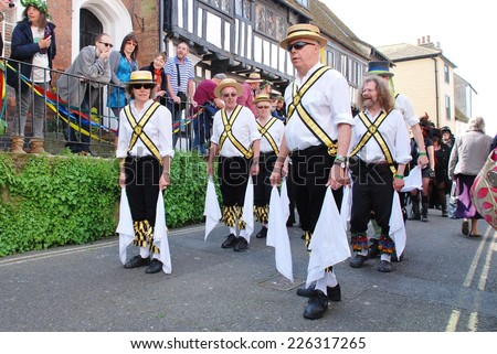 HASTINGS, ENGLAND - MAY 5, 2014: Leading Lights Morris perform at the parade through the Old Town during the annual Jack In The Green festival. The event marks the May Day public holiday in Britain. - stock photo