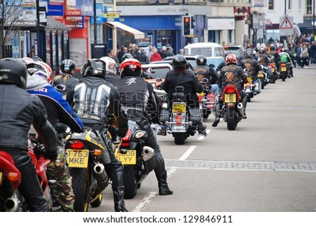 HASTINGS, ENGLAND - MAY 7: Motorcyclists ride through the streets during the annual May Day motorcycle rally on May 7, 2012 at Hastings, East Sussex. The event attracts thousands of riders each year. - stock photo