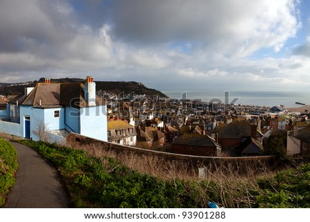 Hastings fishing village, view of the old town. seaside holiday resort in east sussex in England. cityscape with english houses - stock photo