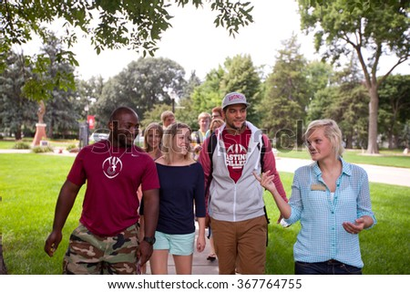 HASTINGS, NE - August 17th, 2013 - Students on the Hastings College campus hang out during the opening week of school. The school a private, undergraduate, four-year, religious liberal arts college.  - stock photo