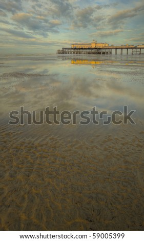 Hastings Pier at sunrise with warm glow