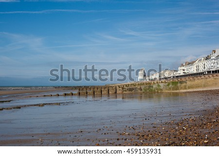 Hastings sea front in a low tide, East Sussex, England, view to the west of the pier, selective focus on the nearest sea groin
