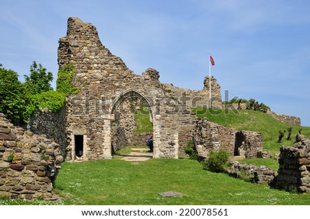 HASTINGS, UK - MAY 17. The ruins of Hastings castle and chapel on May 17, 2014. The site dates from 1067 with a history of  destruction, erosion and World War two bombings at Hastings, East Sussex. - stock photo