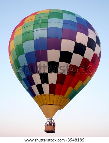Hat air balloon take off with people aboard. - stock photo