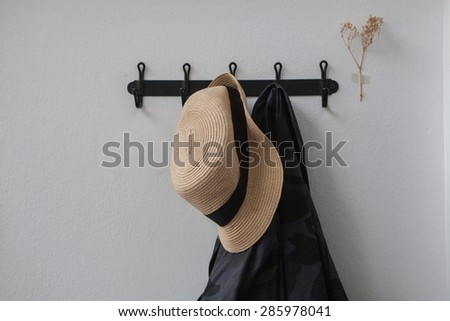 hat and clothes with hanger  - stock photo