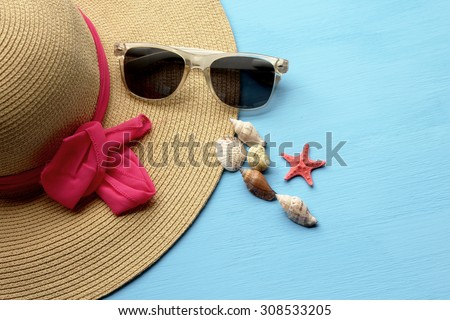 Hat and sunglasses - summertime fashion  - stock photo