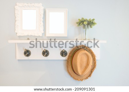 Hat hang on the  wall with picture frames - stock photo