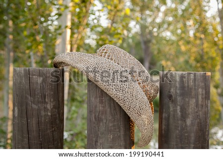hat in field with fences - stock photo