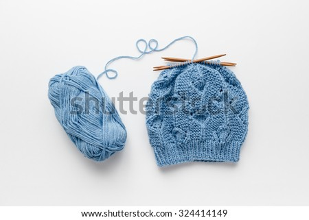 Hat knitted with four knitting needles