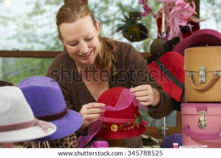 Hat Maker Working On Design In Studio