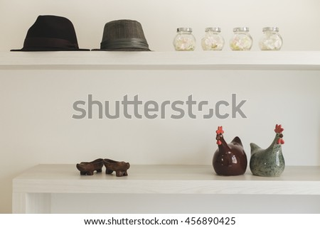 hat on wooden desk in modern living room, Decorate furniture - stock photo