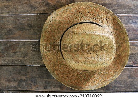 hat on wooden table - stock photo