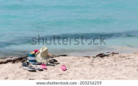 Hat shoes, clothes and hat on a sandy beach. Concept of summertime vacations, Ayia Napa, Cyprus