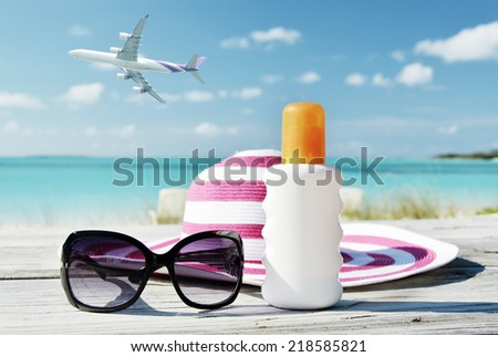 Hat, sunglasses and sun lotion. Exuma, Bahamas - stock photo