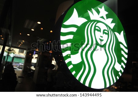 HAT YAI - MAY 16: Exterior view of a Starbucks store in the city centre on May 16, 2013 in Hat Yai, Thailand. Starbucks is the world's largest coffee house with over 20,000 stores in 61 countries. - stock photo